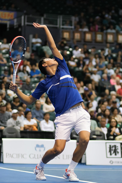 Brandon Nakashima coils his body during his serve attempt against Sam Querrey in the finals of the men's draw of the 2019 Hawaii Open at the Stan Sheriff Center on December 28, 2019 in Honolulu, Hawaii.