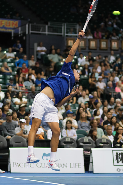 Brandon Nakashima strikes a serve against Sam Querrey in the finals of the men's draw of the 2019 Hawaii Open at the Stan Sheriff Center on December 28, 2019 in Honolulu, Hawaii.