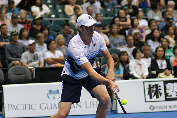 Sam Querrey hits a forehand volley against Brandon Nakashima in the men's finals of the 2019 Hawaii Open at the Stan Sheriff Center on December 28, 2019 in Honolulu, Hawaii.