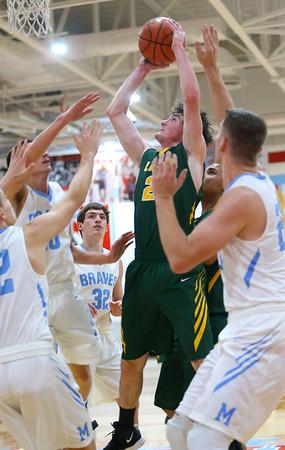 1-3-19<br /> Maconaquah vs Eastern boys basketball<br /> Eastern's Ethan Wilcox puts up a shot surrounded by Mac's defense.<br /> Kelly Lafferty Gerber | Kokomo Tribune