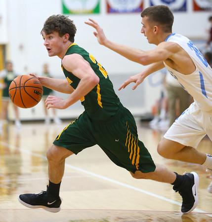 1-3-19<br /> Maconaquah vs Eastern boys basketball<br /> Eastern's Ethan Wilcox dribbles toward the basket.<br /> Kelly Lafferty Gerber | Kokomo Tribune