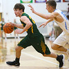 1-3-19<br /> Maconaquah vs Eastern boys basketball<br /> Eastern's Ethan Wilcox dribbles toward the basket.<br /> Kelly Lafferty Gerber | Kokomo Tribune