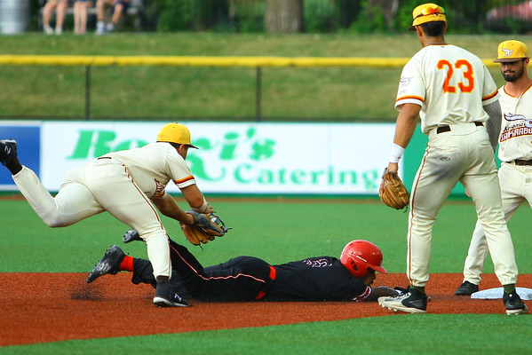 Kokomo Jackrabbits host the Battle Creek Bombers with Joseph Myers chasing down Roy Thurman for an out as he tried to steel third in the 3rd inning on July 10, 2019. <br /> Tim Bath | Kokomo Tribune