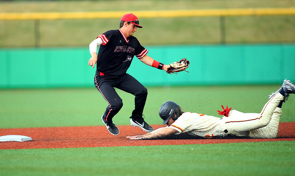 Hagan Severance slides in safely to 2nd in the 3rd inning with Kelby Weyler missing the tag as Kokomo Jackrabbits host the Battle Creek Bombers on July 10, 2019. <br /> Tim Bath | Kokomo Tribune