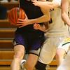 11-30-19<br /> Northwestern vs Eastern boys basketball<br /> NW's Nathan Bennett drives the ball under the goal.<br /> Kelly Lafferty Gerber | Kokomo Tribune