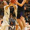 11-30-19<br /> Northwestern vs Eastern boys basketball<br /> Eastern's Evan Monize and NW's Eli Edwards go after a rebound.<br /> Kelly Lafferty Gerber | Kokomo Tribune