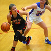 11-13-19<br /> Taylor vs Kokomo girls basketball<br /> Taylor's Austyn Huffer looks to get around Kokomo's Brook Reaves.<br /> Kelly Lafferty Gerber | Kokomo Tribune
