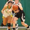 11-7-19<br /> Eastern vs Western girls basketball<br /> Eastern's Jeanie Crabtree looks to steal the ball from Morgan Ousley.<br /> Kelly Lafferty Gerber | Kokomo Tribune