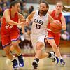 11-20-19<br /> Cass vs Kokomo girls basketball<br /> Cass' Kyndal Silcox takes the ball down the court.<br /> Kelly Lafferty Gerber | Kokomo Tribune