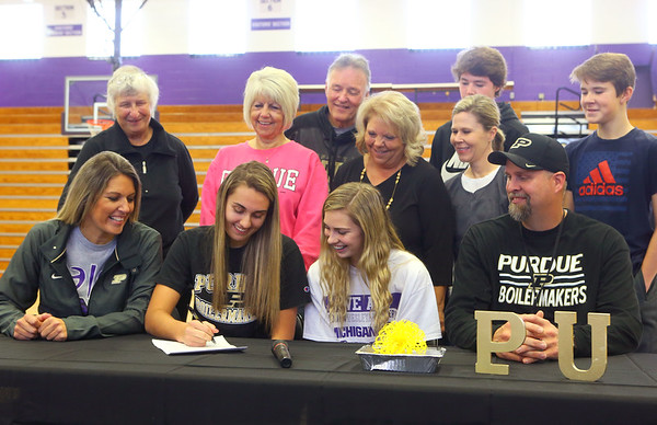11-13-19<br /> Surrounded by family and coaches, Madison Layden, center, signs to play basketball at Purdue.<br /> Kelly Lafferty Gerber | Kokomo Tribune