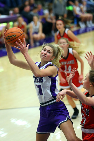 McKenna Layden rebounding in the first half as Northwestern girls defeated Twin Lakes 80-28 on Saturday Nov. 9, 2019.<br /> Tim Bath | Kokomo Tribune