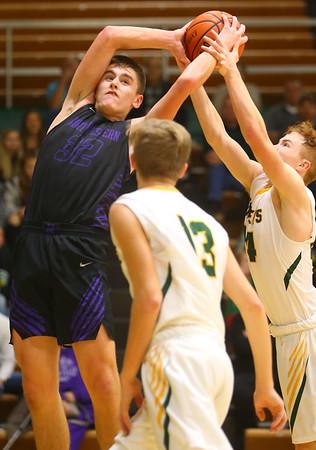 11-30-19<br /> Northwestern vs Eastern boys basketball<br /> NW's Eli Edwards and Eastern's Karson West go after a rebound.<br /> Kelly Lafferty Gerber | Kokomo Tribune