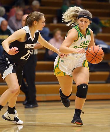 11-7-19<br /> Eastern vs Western girls basketball<br /> Eastern's Jeanie Crabtree takes the ball down the court.<br /> Kelly Lafferty Gerber | Kokomo Tribune