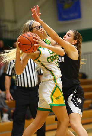 11-7-19<br /> Eastern vs Western girls basketball<br /> Eastern's Lexi James looks to pass around Western's Audrey Rassel.<br /> Kelly Lafferty Gerber | Kokomo Tribune