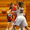 11-20-19<br /> Cass vs Kokomo girls basketball<br /> Kokomo's Natalija Garevska looks for a pass around Cass' Paxtyn Hicks.<br /> Kelly Lafferty Gerber | Kokomo Tribune