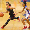11-13-19<br /> Taylor vs Kokomo girls basketball<br /> Taylor's Alison Pemberton takes the ball down the court.<br /> Kelly Lafferty Gerber | Kokomo Tribune