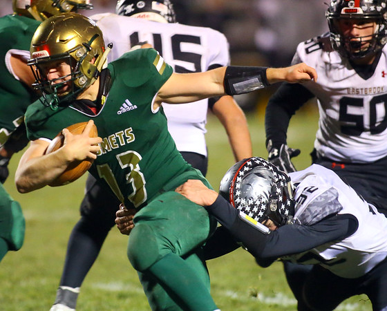 11-8-19<br /> Eastern vs Eastbrook sectional football championship<br /> Zane Downing looks to outrun Easbrook's defense.<br /> Kelly Lafferty Gerber | Kokomo Tribune