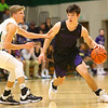 11-30-19<br /> Northwestern vs Eastern boys basketball<br /> NW's Mason Estle takes the ball down the court.<br /> Kelly Lafferty Gerber | Kokomo Tribune