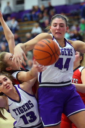 Sarah Heaver and Kendall Bostic going up for a rebound as Northwestern girls defeated Twin Lakes 80-28 on Saturday Nov. 9, 2019.<br /> Tim Bath   Kokomo Tribune
