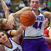 Sarah Heaver and Kendall Bostic going up for a rebound as Northwestern girls defeated Twin Lakes 80-28 on Saturday Nov. 9, 2019.<br /> Tim Bath | Kokomo Tribune