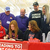 11-13-19<br /> Surrounded by family and coaches, Klair Merrell, center, signs to play basketball at Indiana Wesleyan.<br /> Kelly Lafferty Gerber | Kokomo Tribune