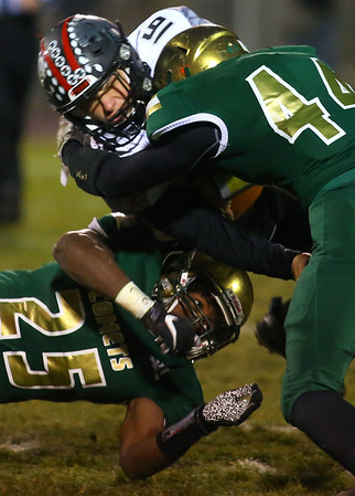 11-8-19<br /> Eastern vs Eastbrook sectional football championship<br /> Makhai Reed and Tallan Morrisett take down Eastbrook's Dylan Bragg.<br /> Kelly Lafferty Gerber | Kokomo Tribune