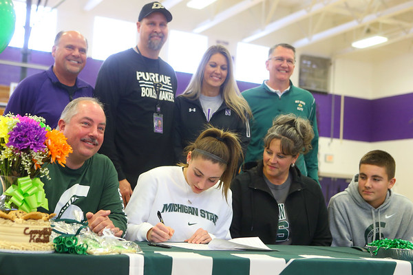 11-13-19<br /> Surrounded by family and coaches, Kendall Bostic, center, signs to play basketball at Michigan State.<br /> Kelly Lafferty Gerber   Kokomo Tribune