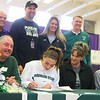 11-13-19<br /> Surrounded by family and coaches, Kendall Bostic, center, signs to play basketball at Michigan State.<br /> Kelly Lafferty Gerber | Kokomo Tribune