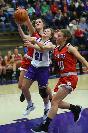 Kate Miller is fouled while trying to put the ball up sending her to the line. Northwestern girls defeated Twin Lakes 80-28 on Saturday Nov. 9, 2019.<br /> Tim Bath   Kokomo Tribune