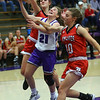 Kate Miller is fouled while trying to put the ball up sending her to the line. Northwestern girls defeated Twin Lakes 80-28 on Saturday Nov. 9, 2019.<br /> Tim Bath | Kokomo Tribune