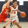 11-27-19<br /> Taylor vs Frankton boys basketball<br /> Taylor's Jaylen Harris takes the ball down the court.<br /> Kelly Lafferty Gerber | Kokomo Tribune