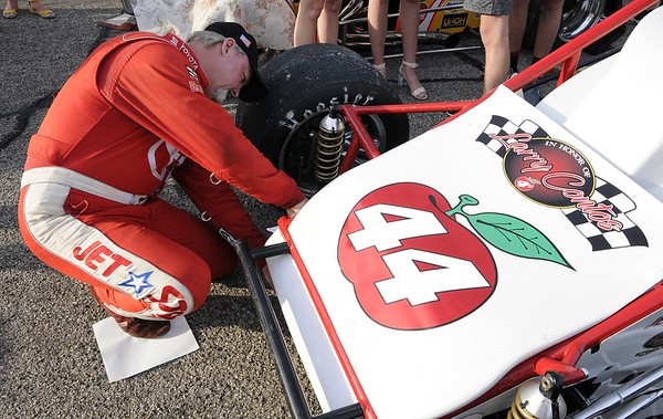Don Knight   The Herald Bulletin<br /> Brian Tyler adds a decal to the 44 car before the Payless Little 500 on Saturday.