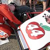 Don Knight | The Herald Bulletin<br /> Brian Tyler adds a decal to the 44 car before the Payless Little 500 on Saturday.
