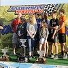 Don Knight | The Herald Bulletin<br /> Contos family on stage as Larry Contos was honored before the start of the Payless Little 500 on Saturday.