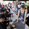 Don Knight | The Herald Bulletin<br /> Fans get driver autographs before the start of the Little 500 on Saturday.