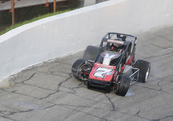 Don Knight | The Herald Bulletin<br /> Caleb Armstrong goes into the wall for the first caution of the Payless Little 500 on Saturday.