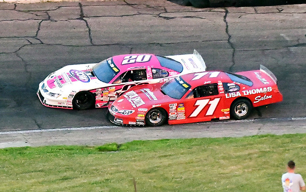 John P. Cleary | The Herald Bulletin<br /> 53rd annual Redbud 400 at Anderson Speedway. Race winner Johnny VanDoorn gets the inside position on Jack Dossey III to make the pass, and take the lead back, on lap 383. VanDoorn lead 338 of the 400 laps.