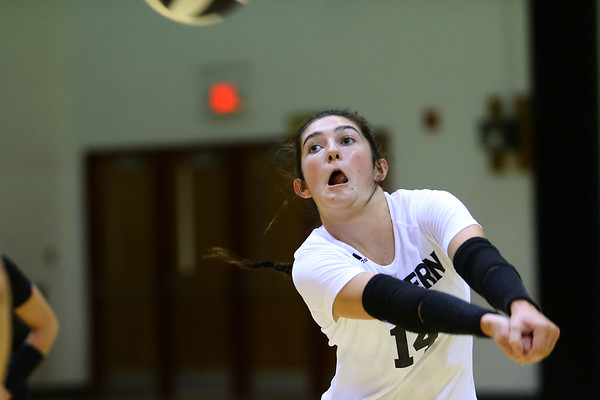 Taylor Scott recovers a wild ball during volleyball action between Western HS and Cass HS on Sept. 24, 2019. <br /> Tim Bath | Kokomo Tribune