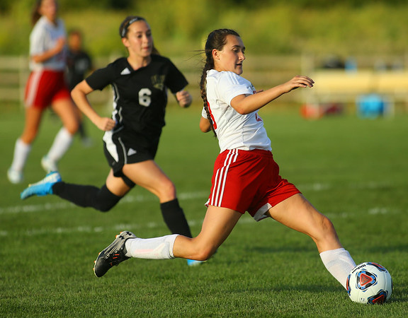 9-4-19<br /> Taylor vs Peru girls soccer<br /> Lynzey Butzin heads for the goal.<br /> Kelly Lafferty Gerber | Kokomo Tribune