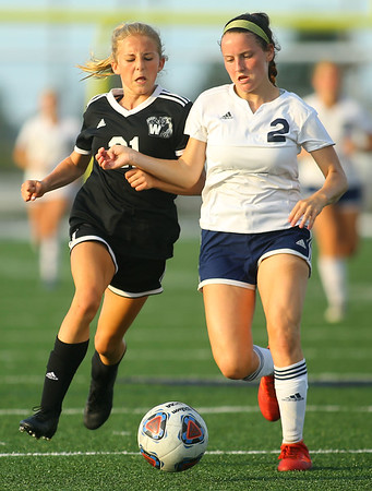 9-28-19<br /> Western vs Central Catholic girls soccer Hoosier Conference Tournament<br /> Western's Lucy Weigt and Central Catholic's Aubrey Weeks go after the ball.<br /> Kelly Lafferty Gerber | Kokomo Tribune