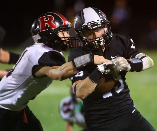9-6-19<br /> Western vs Rensselaer football<br /> Western's Jerry Padgett tries to outrun Rensselaer's Elijah Hickman.<br /> Kelly Lafferty Gerber | Kokomo Tribune