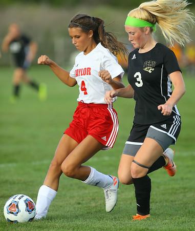 9-4-19<br /> Taylor vs Peru girls soccer<br /> Taylor's Alison Pemberton controls the ball over Peru's Claire Boyer.<br /> Kelly Lafferty Gerber | Kokomo Tribune