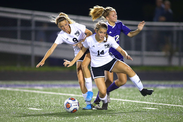 Western's Maddy Parr and Abigail Fouts cut off Rebecca Lagoni as she dribbles down field as Western HS girls defeat Northwestern HS 3-0 on Sept. 19, 2019.<br /> Tim Bath | Kokomo Tribune