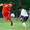 Gabriel Araujo-Lange doing some fancy footwork to get by Raul Rodriguez in soccer between Kokomo High School and Logansport High School on Sept. 17, 2019. He scored Kokomo's only goal loosing 2-1.<br /> Tim Bath | Kokomo Tribune
