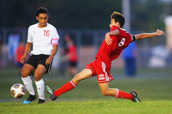 Gabriel Araujo-Lange shoots in soccer between Kokomo High School and Logansport High School on Sept. 17, 2019. He scored Kokomo's only goal loosing 2-1.<br /> Tim Bath | Kokomo Tribune