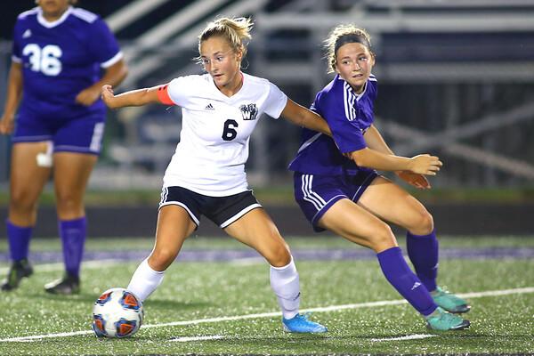 Sophia Weigt and Ashlyn Markley going for the ball as Western HS girls defeat Northwestern HS 3-0 on Sept. 19, 2019.<br /> Tim Bath | Kokomo Tribune