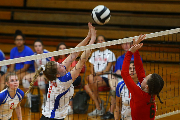 Corell Heath pops the ball over the net as Kokomo High School volleyball team defeats North Miami High School on Sept. 18, 2019.<br /> Tim Bath | Kokomo Tribune