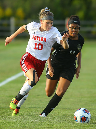 9-4-19<br /> Taylor vs Peru girls soccer<br /> Taylor's Fallon Shane races after the ball alongside Peru's Aleesha Zehring.<br /> Kelly Lafferty Gerber | Kokomo Tribune