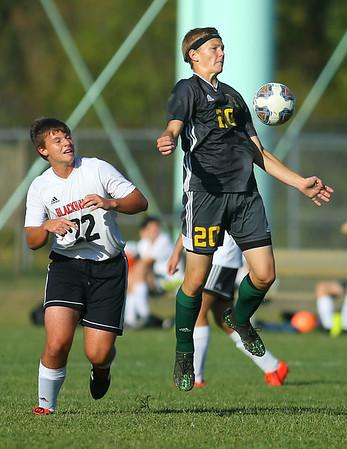 9-26-19<br /> Eastern vs Sheridan boys soccer<br /> Eastern's Evan Spell tries to ground the ball.<br /> Kelly Lafferty Gerber | Kokomo Tribune