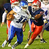 9-13-19<br /> Cass vs Tipton football<br /> Tipton's Gerardo Fortuna tries to get out of the clutches of Cass' Joey Humphrey.<br /> Kelly Lafferty Gerber | Kokomo Tribune